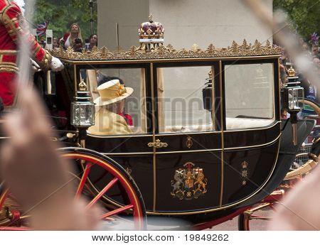 LONDON, UK - APRIL 29: Queen Elizabeth in her coach at Prince William and Kate Middleton wedding, April 29, 2011 in London, United Kingdom