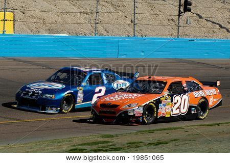 AVONDALE, AZ - NOV 7 - Tony Stewart (20) and Casey Mears (5) compete in the NASCAR Sprint Cup Series at the Phoenix International Raceway on November 7, 2008 in Avondale, Arizona.
