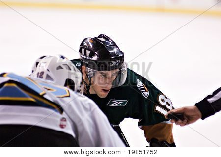 PHOENIX, AZ - DECEMBER 18: Utah Grizzlies forward James Sixsmith (#18) waits for the face-off during the ECHL hockey game against the Phoenix Roadrunners on December 18, 2008 in Phoenix, Arizona.