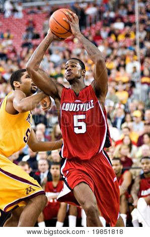 GLENDALE, AZ - DECEMBER 20: Earl Clark #5 of Louisville passes the ball as Ralph Sampson #50 of Minnesota defends in the basketball game on December 20, 2008 in Glendale, Arizona.