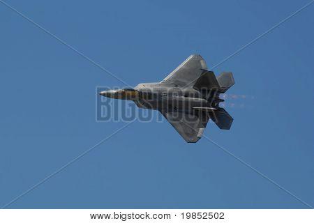 GLENDALE, AZ - MARCH 21: A U.S. Air Force F-22 Raptor makes a knife edge pass at the biennial air show (