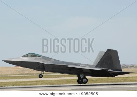 GLENDALE, AZ - MARCH 21: A U.S. Air Force F-22 Raptor lands on the runway at the biennial air show (