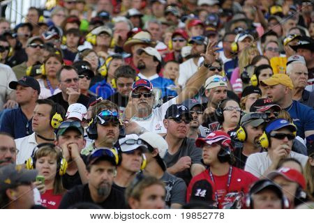 AVONDALE, AZ - APRIL 18: Fans in the grandstand watch the NASCAR Sprint Cup race at the Phoenix International Raceway on April 18, 2009 in Avondale, AZ.