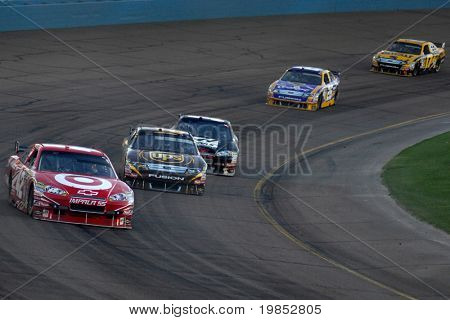 AVONDALE, AZ - APRIL 18: Juan Pablo Montoya leads a group of cars in the NASCAR Sprint Cup race at the Phoenix International Raceway on April 18, 2009 in Avondale, AZ.
