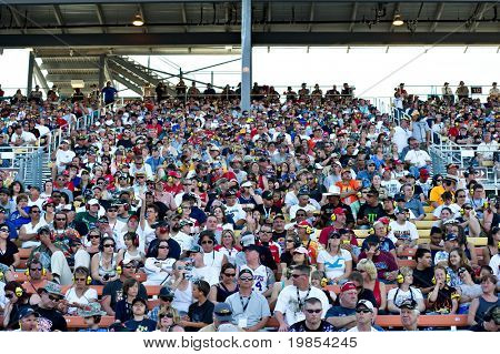 AVONDALE, AZ - APRIL 10: Fans in the grandstand at the Subway Fresh Fit 600 NASCAR Sprint Cup race on April 10, 2010 in Avondale, AZ.