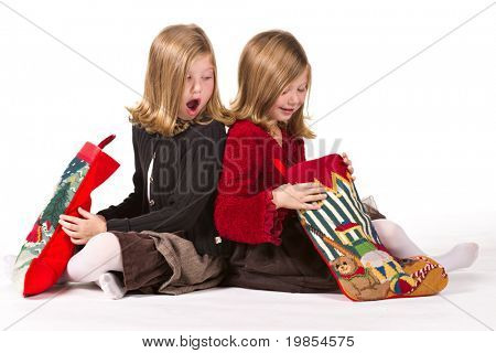 Beautiful twin sisters opening Christmas gifts