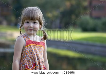 Pretty Little Girl In Park