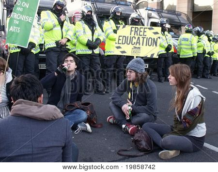 LONDON - DEC 9: Students demonstration against university fee rises in front of police lines at the houses of parliament buildings London, dec 9, 2010.