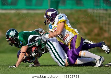 KORNEUBURG, AUSTRIA - APRIL18: Danube Dragons WR Thomas Haider (No. 13) in action as his team win 57:30 against the Vienna Vikings at Austrian Football League April 18, 2009 in Korneuburg.