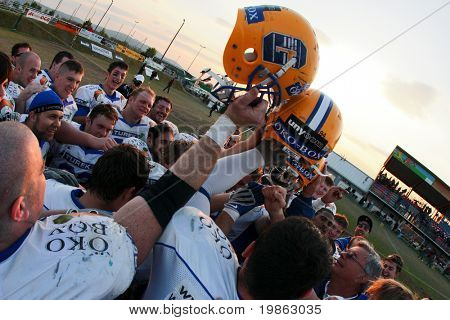 KORNEUBURG, AUSTRIA - MAY 3: Graz Giants celebrate when they beat the Danube Dragons at Austrian Football League 16:34 on May 3, 2009 in Korneuburg.