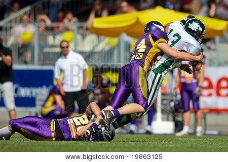 VIENNA,  AUSTRIA - MAY 10:Austrian Football League:  WR Thomas Haider (#13, Dragons) and the Danube Dragons  beat the Vienna Vikings 24:27 on May 10, 2009 in Vienna, Austria.