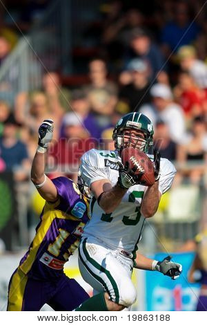 VIENNA - MAY 10:  WR Thomas Haider (#13, Dragons) in action as the Danube Dragons  beat the Vienna Vikings 24:27 at Austrian Football League on May 10, 2009 in Vienna, Austria.