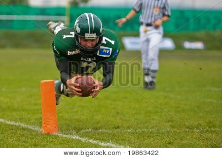 KORNEUBURG,  AUSTRIA - JUNE 20: Austrian Football League: QB Ryan Rufener (#7, Dragons) and his team win 41:35 against the Carinthian Black Lions on June 20, 2009 in Korneuburg, Austria.