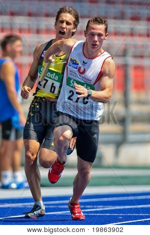 LINZ, AUSTRIA - AUGUST 2 Austrian track and field championship: Benjamin Grill (back) and Norbert Schrott (front) place fourth in the men's 4x100m relay on August 2, 2009 in Linz, Austria.