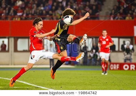 VIENNA,  AUSTRIA - MARCH 25 Austria loses to Belgium 0:2 in a qualifying match for EURO 2012 on March 25, 2011  in Vienna, Austria. Shown are Martin Harnik (#19, Austria), Axel Witsel (#10, Belgium).