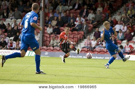 LONDON, UK AUGUST 16,Craig Poole Shoots at the Grimsby goal playing in the Coca-Cola football league two match between Brentford and Grimsby town at Griffin Park London August 16, 2008