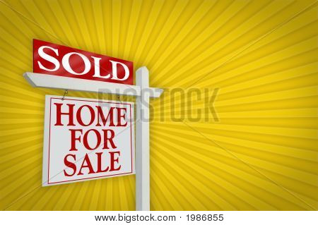Sold Home For Sale Sign On Burst