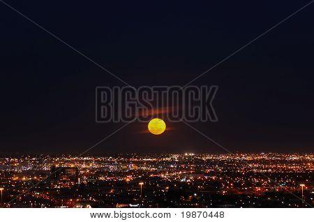 Full Moon Rising over City