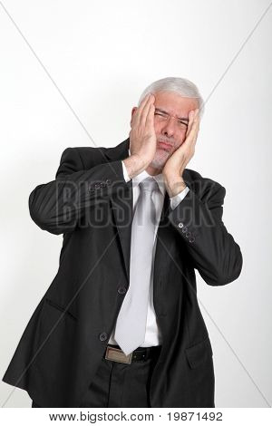 Businessman with annoyed look on his face