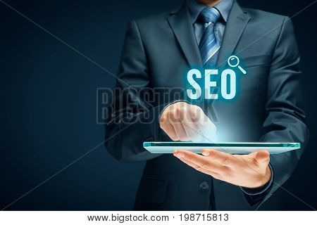 poster of Search engine optimization - SEO concept. Businessman or programmer is focused to improve SEO and web traffic.