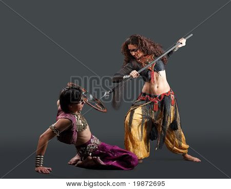 traditional costume - ritual dance with weapon