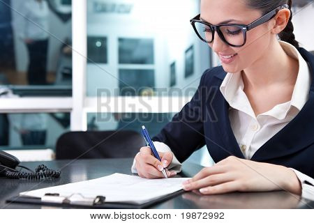 Young Businesswoman Signing A Contract