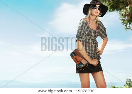 Cute woman over blue sky background