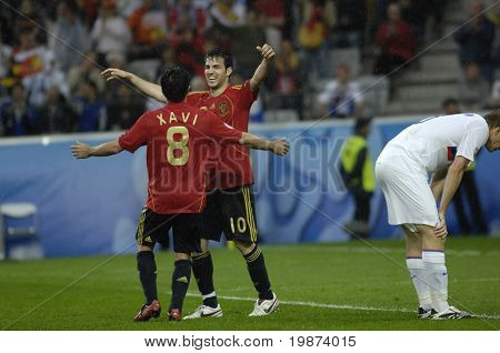INNSBRUCK - JUNE 10: Cesc Fabregas and Xavi of Spain Football National Team during the match Spain-Russia 4:1 Euro2008 Group D. Fabregas scored the last goal. June 10, 2008, in Innsbruck, Austria