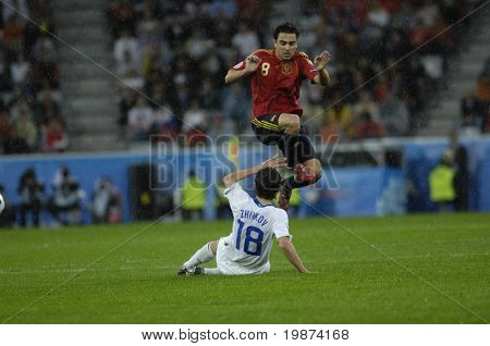 INNSBRUCK - JUNE 10: Yuri Zhirkov of Russia (in white) & Xavi of Spain (in red)  during the match Spain-Russia 4:1 Euro2008 Group D. June 10, 2008, in Innsbruck, Austria