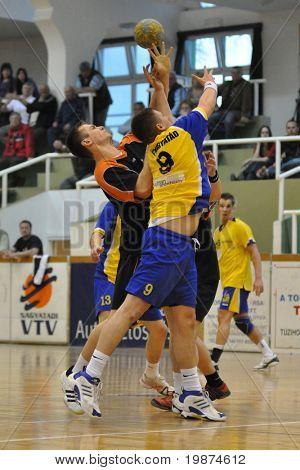 NAGYATAD, HUNGARY - APRIL 5: Istvan Kovacs (number 9) in action at Hungarian National Handball Championship match (Nagyatad vs. Papa) April 5, 2009 in Nagyatad, Hungary.