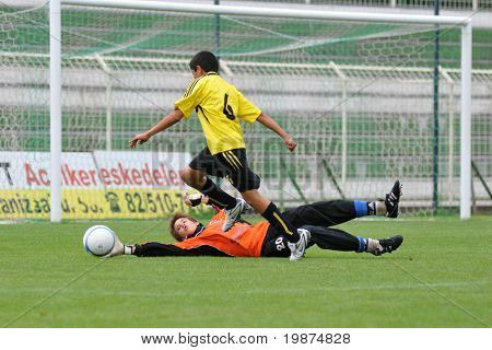KAPOSVAR, HUNGARY - JULY 24: Unidentified players in action at the V. Youth Football Festival Under 13 Final - Cantolao (PER) vs Pecsi MFC (HUN) - July 24, 2009 in Kaposvar, Hungary