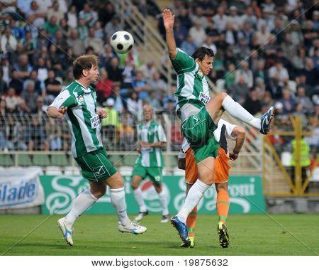 KAPOSVAR, HUNGARY - AUGUST 29: Viktor Petrok (L) and Krisztian Pest in action at Hungarian National Championship soccer game Kaposvar vs Ferencvaros August 19, 2009 in Kaposvar, Hungary.