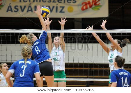 KAPOSVAR, HUNGARY - DECEMBER 17: Timea Kondor (blue 8) strikes the ball at the Hungarian Extra League woman volleyball game between Kaposvar and Miskolc , December 17, 2008 in Kaposvar, Hungary.