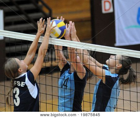 KAPOSVAR, HUNGARY - SEPTEMBER 13: Sakovics (l), Kondor (c) and Harmath in action at the Hungarian Extra League woman volleyball game Kaposvar vs TFSE, September 13, 2009 in Kaposvar, Hungary