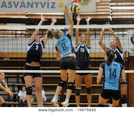 KAPOSVAR, HUNGARY - SEPTEMBER 13: Timea Kondor (8) strikes the ball at the Hungarian Extra League woman volleyball game Kaposvar vs TFSE, September 13, 2009 in Kaposvar, Hungary