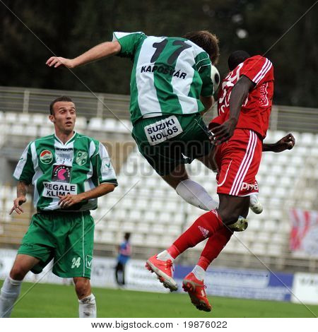 KAPOSVAR, HUNGARY - SEPTEMBER 25: Petrok (C) and Coulibaly (R) in action at a Hungarian National Championship soccer game Kaposvar vs Debrecen September 25, 2009 in Kaposvar, Hungary.