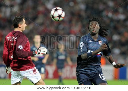 BUDAPEST - SEPTEMBER 29: Poleksic (L) and Gomis in action at the UEFA Champions League football game Debrecen vs Lyon, September 29, 2009 in Budapest, Hungary.