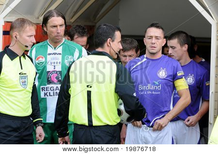 KAPOSVAR, HUNGARY - OCTOBER 17: Zahorecz (white-green) and Kabat (lilac) before at a Hungarian National Championship soccer game Kaposvar vs Ujpest October 17, 2009 in Kaposvar, Hungary.