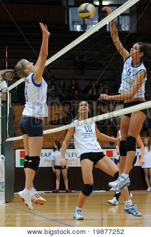 KAPOSVAR, HUNGARY - OCTOBER 14: Kondor (L) and Csengeri (R) in action at the Hungarian Cup woman volleyball game Kaposvar vs Godollo, October 14, 2009 in Kaposvar, Hungary.