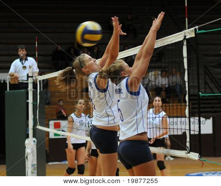KAPOSVAR, HUNGARY - OCTOBER 14: Kondor (8) and Horvath (5) in action at the Hungarian Cup woman volleyball game Kaposvar vs Godollo, October 14, 2009 in Kaposvar, Hungary.