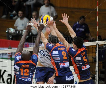 KAPOSVAR, HUNGARY - NOVEMBER 6: Gato (12), Pajenk (2) and Sket (5) blocks the ball at a Middle European League volleyball game Kaposvar (HUN) vs ACH Bled (SLO), November 6, 2009 in Kaposvar, Hungary