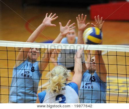 KAPOSVAR, HUNGARY - OCTOBER 25: Timea Kondor (8) and Gabriella Kondor (13) in action at the Hungarian NB I. League woman volleyball game Kaposvar vs Eger, October 25, 2009 in Kaposvar, Hungary.