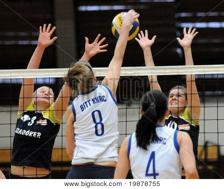 KAPOSVAR, HUNGARY - JANUARY 17: Timea Kondor (8) strikes the ball at the Hungarian NB I. League woman volleyball game Kaposvar vs Eger, January 17, 2010 in Kaposvar, Hungary.
