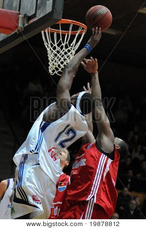 KAPOSVAR, HUNGARY - JANUARY 20: Larry Welton (in white) in action at Hungarian National Championship basketball game with Kaposvar vs Paks on January 20, 2010 in Kaposvar, Hungary.