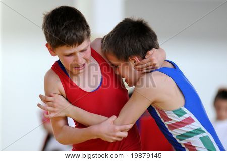 KAPOSVAR, HUNGARY - APRIL 26: Two unidentified competitors wrestle in the Hungarian Wrestling Student Team Championship, April 26, 2008 in Kaposvar, Hungary.