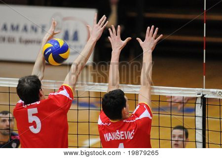 KAPOSVAR, HUNGARY - JANUARY 31: Colic (L) blocks the ball at a Middle European League volleyball game Kaposvar (HUN) vs. Mladost Zagreb (CRO), January 31, 2010 in Kaposvar, Hungary.