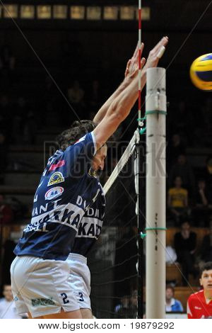 KAPOSVAR, HUNGARY - JANUARY 31: Robert Koch (2) blocks  the ball at a Middle European League volleyball game Kaposvar (HUN) vs. Mladost Zagreb (CRO), January 31, 2010 in Kaposvar, Hungary.