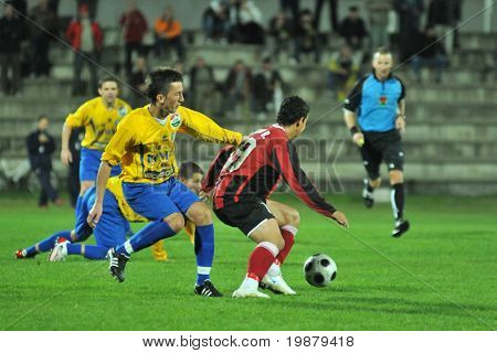 SIOFOK, HUNGARY - OCTOBER 3: Attila Horvath (L) in action at a Hungarian National Championship soccer game Siofok vs. Budapest Honved October 3, 2008 in Siofok, Hungary.