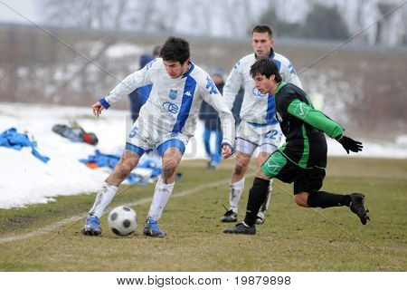 KAPOSVAR, HUNGARY - FEBRUARY 20: Lukacs Bole (r) in action at a friendly soccer game with Kaposvar (HUN) vs NK Osijek (CRO) February 20, 2010 in Kaposvar, Hungary.