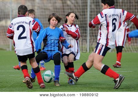 KAPOSVAR, HUNGARY - MARCH 6: Bence Bodo (2nd L) in action at the Hungarian National Championship under 13 game between Kaposvari Rakoczi FC and Mezga FC March 6, 2010 in Kaposvar, Hungary.